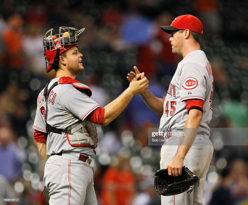 Catcher <a gi-track='captionPersonalityLinkClicked' href=/galleries/search?phrase=Devin+Mesoraco&family=editorial&specificpeople=5745587 ng-click='$event.stopPropagation()'>Devin Mesoraco</a> #39 of the Cincinnati Reds shakes hands with Sean Marshall #45 of the Cincinnati Reds after the final out against the Houston Astros at Minute Maid Park on September 17, 2013 in Houston, Texas.