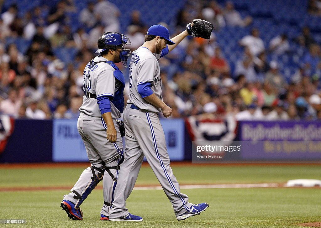 Catcher <a gi-track='captionPersonalityLinkClicked' href=/galleries/search?phrase=Dioner+Navarro&family=editorial&specificpeople=593062 ng-click='$event.stopPropagation()'>Dioner Navarro</a> #30 of the Toronto Blue Jays comes out to speak with pitcher Drew Hutchison #36 of the Toronto Blue Jays after Hutchinson walked Desmond Jennings #8 of the Tampa Bay Rays and James Loney #21 of the Tampa Bay Rays during the second inning of a game on April 1, 2014 at Tropicana Field in St. Petersburg, Florida.