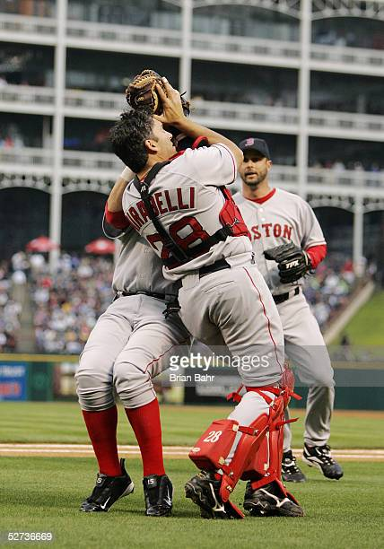 Catcher Doug Mirabelli of the Boston Red Sox pulls in a pop up by Rod Barajas of the Texas Rangers while managing to avoid first baseman Kevin Millar...