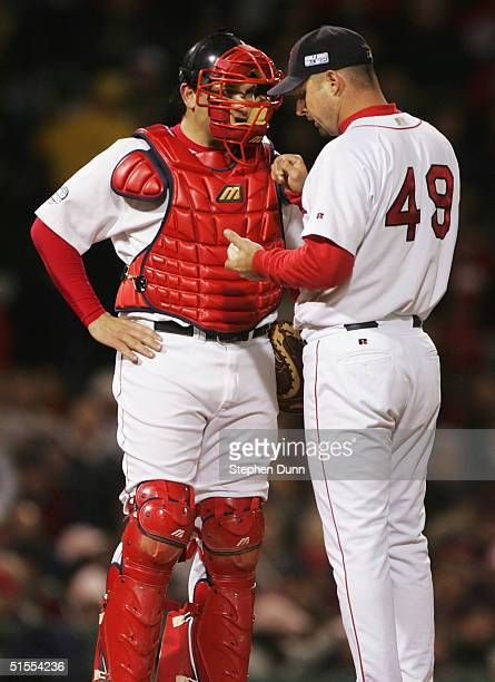 Catcher Doug Mirabelli of the Boston Red Sox talks to Tim Wakefield on the mound during the fourth inning of game one of the World Series against the...