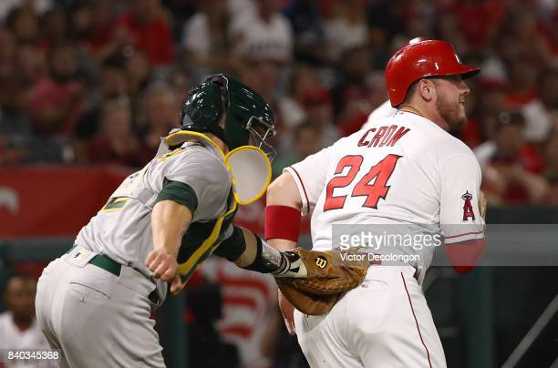 Catcher Dustin Garneau of the Oakland Athletics tags out CJ Cron of the Los Angeles Angels of Anaheim as Cron runs back to third base during the...