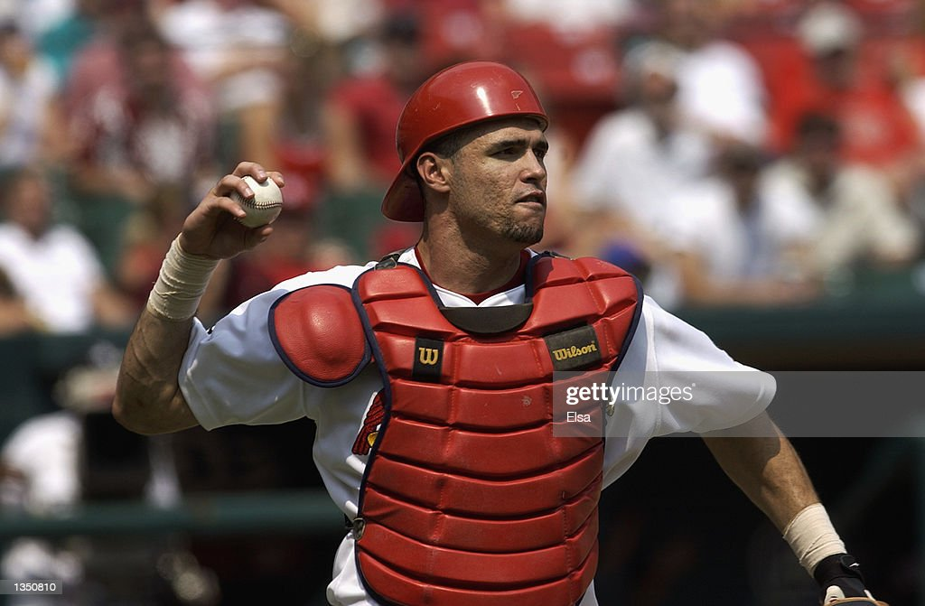 Catcher Eli Marrero of the St Louis Cardinals comes up firing during the MLB game against the New York Mets at Busch Stadium on August 10 2002 in St...