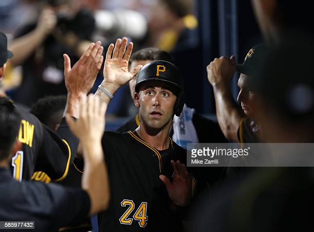 Catcher Eric Fryer of the Pittsburgh Pirates is congratulated in the dugout after scoring in the third inning inning during the game against the...