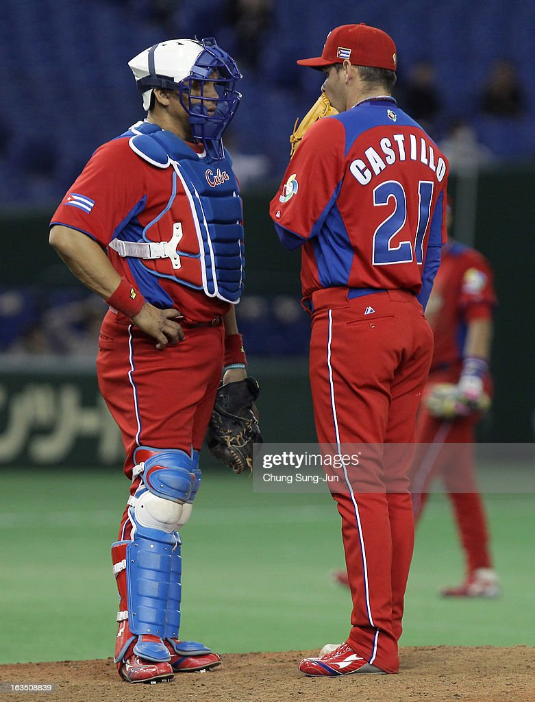 Catcher Eriel Sanchez # 5 and pitcher Diosdany Castillo # 21 of Cuba confer in the ninth inning during the World Baseball Classic Second Round Pool 1 game between Cuba and the Netherlands at Tokyo Dome on March 11, 2013 in Tokyo, Japan.