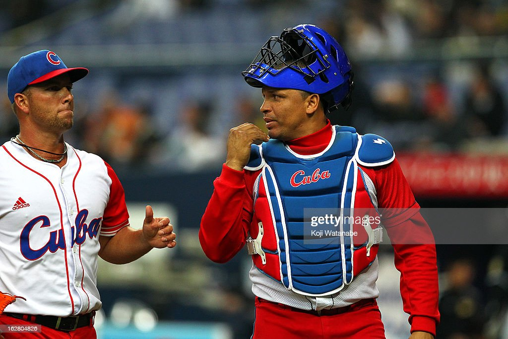 Catcher <a gi-track='captionPersonalityLinkClicked' href=/galleries/search?phrase=Eriel+Sanchez&family=editorial&specificpeople=2948809 ng-click='$event.stopPropagation()'>Eriel Sanchez</a> #5 in action during the friendly game between Hanshin Tigers and Cuba at Kyocera Dome Osaka on February 27, 2013 in Osaka, Japan.