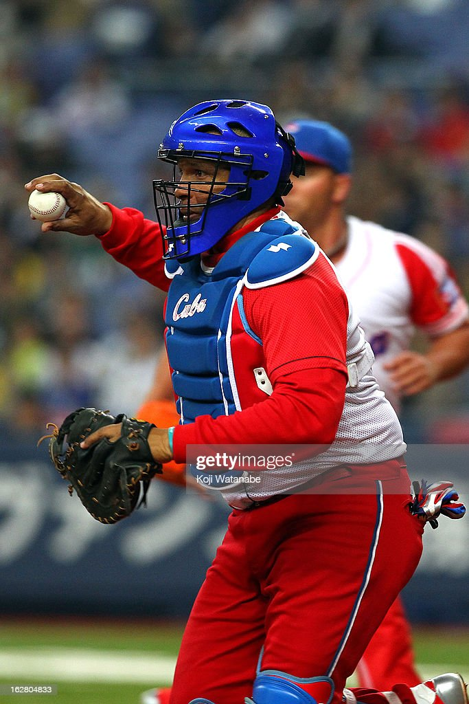 Catcher <a gi-track='captionPersonalityLinkClicked' href=/galleries/search?phrase=Eriel+Sanchez&family=editorial&specificpeople=2948809 ng-click='$event.stopPropagation()'>Eriel Sanchez</a> #5 in action during the friendly game between Hanshin Tigers and Cuba at Kyocera Dome Osaka on February 27, 2013 in Osaka, Japan. Photo by Koji Watanabe/Getty Images)