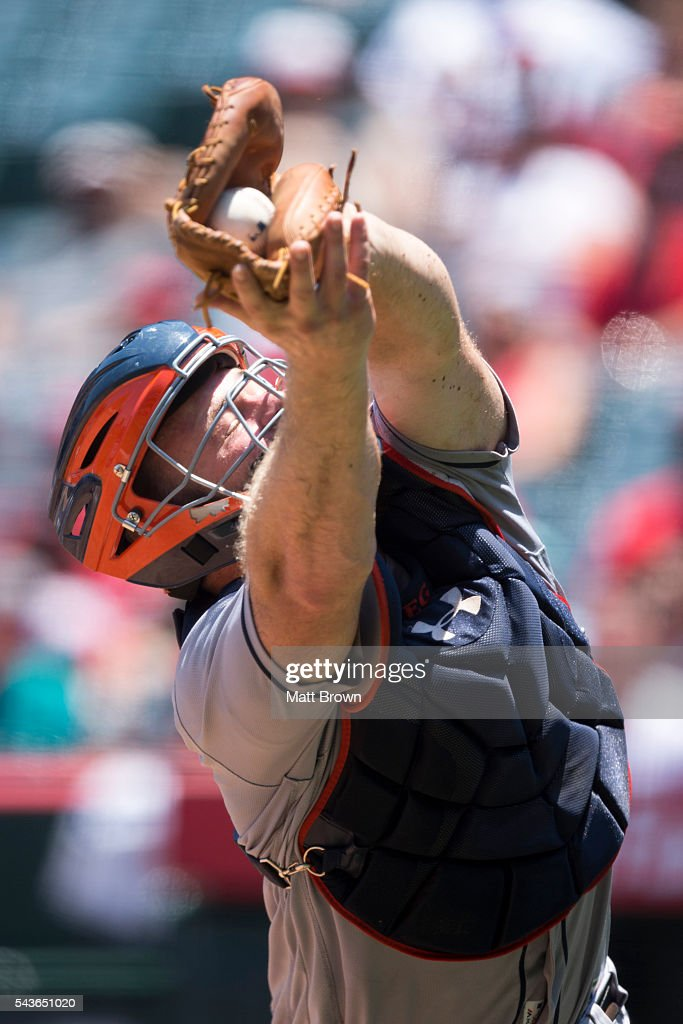 Catcher <a gi-track='captionPersonalityLinkClicked' href=/galleries/search?phrase=Evan+Gattis&family=editorial&specificpeople=8977937 ng-click='$event.stopPropagation()'>Evan Gattis</a> #11 of the Houston Astros catches a a ball popped into foul territory by C.J. Cron #24 of the Los Angeles Angels of Anaheim ending the first inning with bases loaded for the Angels during the game at Angel Stadium of Anaheim on June 29, 2016 in Anaheim, California.