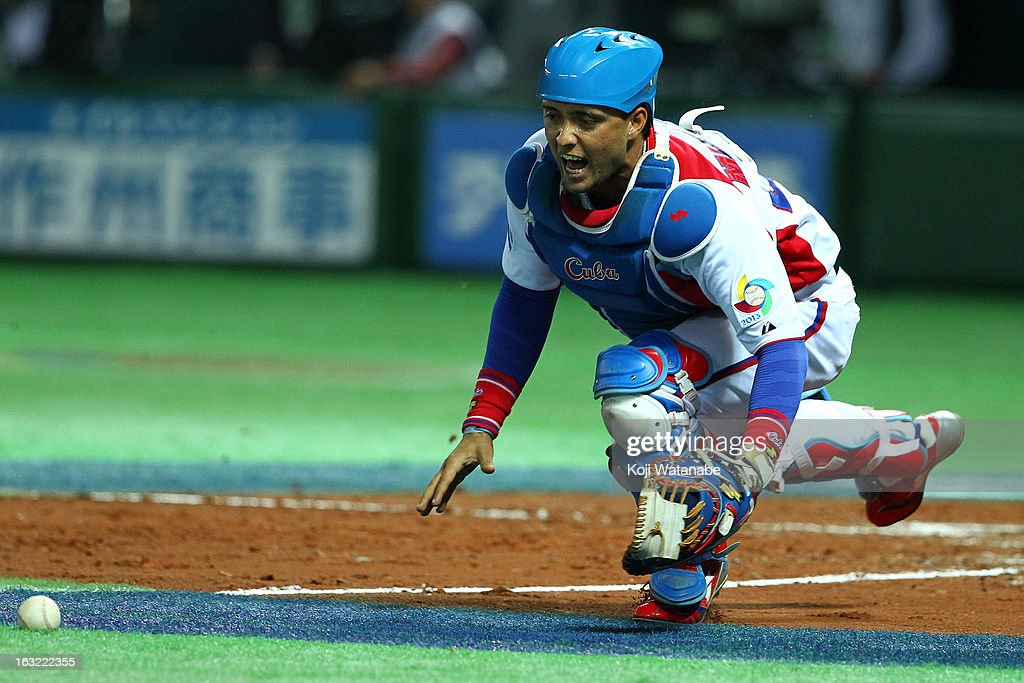 Catcher Frank Morejon #45 of Cuba scrambles for a ball during the World Baseball Classic First Round Group A game between Japan and Cuba at Fukuoka Yahoo! Japan Dome on March 6, 2013 in Fukuoka, Japan.