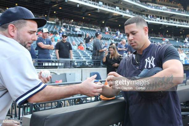 Catcher Gary Sanchez of the New York Yankees signing autographs at batting practice before the New York Yankees Vs New York Mets regular season MLB...