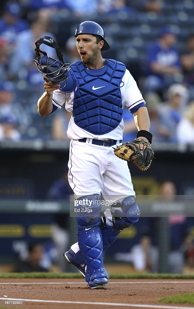 Catcher <a gi-track='captionPersonalityLinkClicked' href=/galleries/search?phrase=George+Kottaras&family=editorial&specificpeople=730633 ng-click='$event.stopPropagation()'>George Kottaras</a> #26 of the Kansas City Royals takes a signal from the bench in the first inning during game two of a doubleheader against the Cleveland Indians at Kauffman Stadium on April 28, 2013 in Kansas City, Missouri.