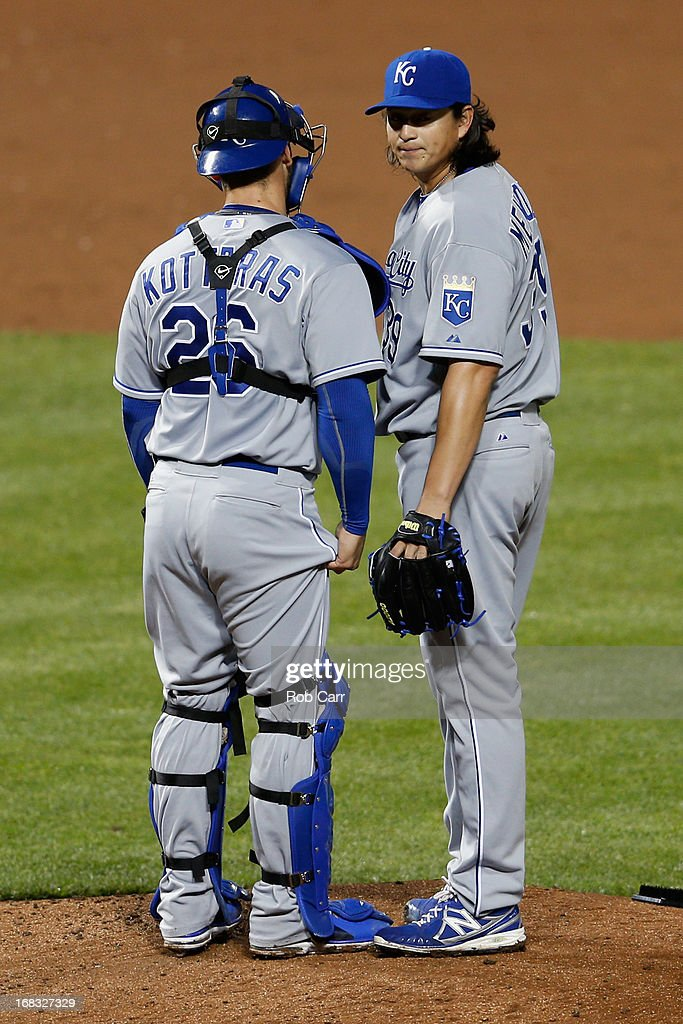 Catcher <a gi-track='captionPersonalityLinkClicked' href=/galleries/search?phrase=George+Kottaras&family=editorial&specificpeople=730633 ng-click='$event.stopPropagation()'>George Kottaras</a> #26 talks with starting pitcher <a gi-track='captionPersonalityLinkClicked' href=/galleries/search?phrase=Luis+Mendoza+-+Jogador+de+basebol&family=editorial&specificpeople=9657658 ng-click='$event.stopPropagation()'>Luis Mendoza</a> #39 of the Kansas City Royals on the mound after giving up a run to the Baltimore Orioles in the fifth inning at Oriole Park at Camden Yards on May 8, 2013 in Baltimore, Maryland.