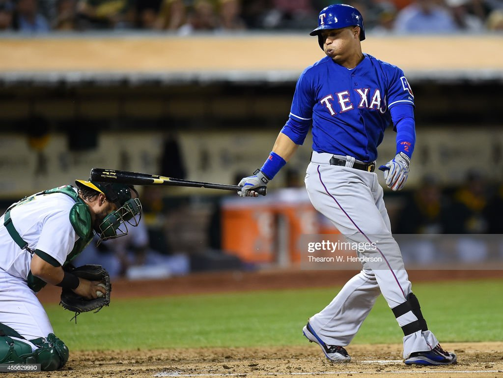 Catcher <a gi-track='captionPersonalityLinkClicked' href=/galleries/search?phrase=Geovany+Soto&family=editorial&specificpeople=743668 ng-click='$event.stopPropagation()'>Geovany Soto</a> #17 of the Oakland Athletics gets hit in the head with the back swing of Leonys Martin #2 of the Texas Rangers in the top of the third inning at O.co Coliseum on September 17, 2014 in Oakland, California.