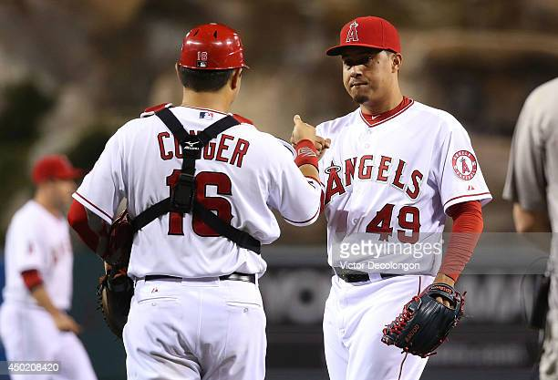 Catcher Hank Conger and pitcher Ernesto Frieri of the Los Angeles Angels of Anaheim celebrate after the MLB game against the Chicago White Sox at...