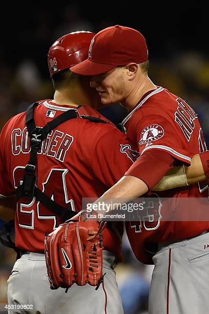 Catcher Hank Conger and pitcher Garrett Richards of the Los Angeles Angels of Anaheim celebrate defeating the Los Angeles Dodgers 50 at Dodger...