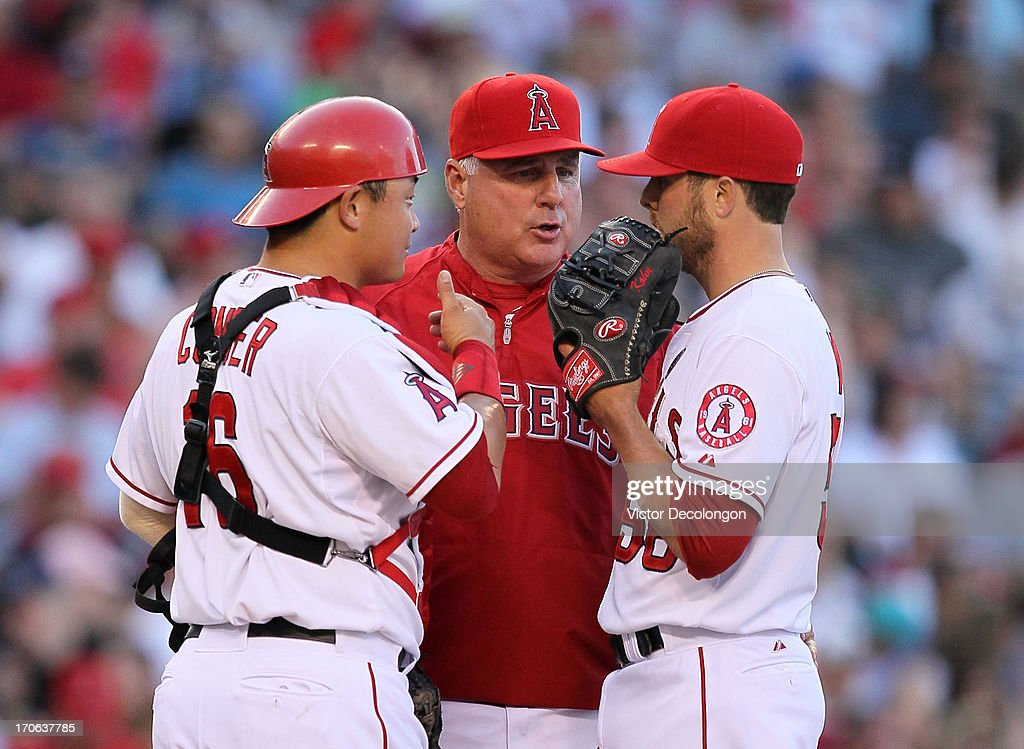 Catcher <a gi-track='captionPersonalityLinkClicked' href=/galleries/search?phrase=Hank+Conger&family=editorial&specificpeople=713039 ng-click='$event.stopPropagation()'>Hank Conger</a> #16, manager <a gi-track='captionPersonalityLinkClicked' href=/galleries/search?phrase=Mike+Scioscia&family=editorial&specificpeople=206319 ng-click='$event.stopPropagation()'>Mike Scioscia</a> and pitcher Michael Kohn #58 of the Los Angeles Angels of Anaheim confer on the mound prior to Kohn taking the mound in relief of Scott Downs #37 (not in photo) in the seventh inning during the MLB game against the New York Yankees at Angel Stadium of Anaheim on June 15, 2013 in Anaheim, California. The Angels defeated the Yankees 6-2.