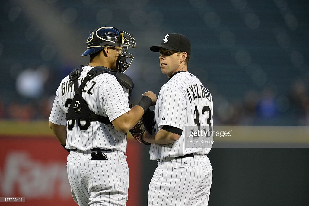 Catcher Hector Gimenez #38 (L) talks with starting pitcher Dylan Axelrod #33 of the Chicago White Sox during the second inning against the Cleveland Indians on April 22, 2012 at U.S. Cellular Field in Chicago, Illinois.