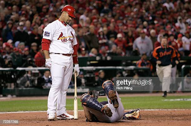 Catcher Ivan Rodriguez of the Detroit Tigers lies on the ground after being hit by a foul tip ball hit by batter Albert Pujols of the St Louis...