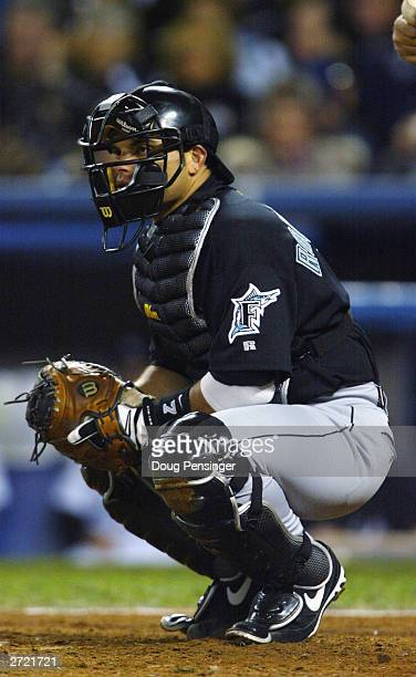 Catcher Ivan Rodriguez of the Florida Marlins is down in his catcher's stance during game 2 of the Major League Baseball World Series against the New...