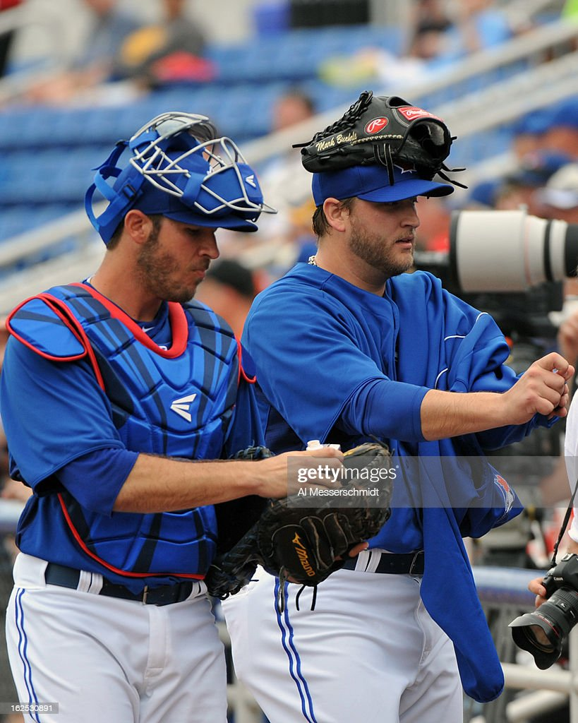 Catcher J. P. Arencibia #9 and pitcher Mark Buehrie #56 of the Toronto Blue Jays rwalks to the dugout before play against the Baltimore Orioles February 24, 2013 at the Florida Auto Exchange Stadium in Dunedin, Florida.