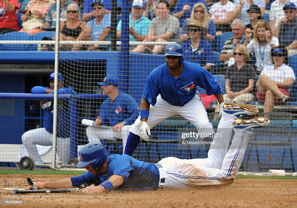 Catcher J. P. Arencibia #9 of the Toronto Blue Jays slides into home plate for a run against the Baltimore Orioles February 24, 2013 at the Florida Auto Exchange Stadium in Dunedin, Florida.