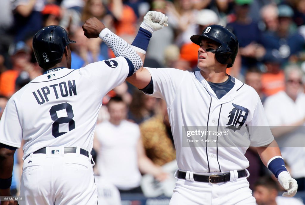 Catcher James McCann #34 of the Detroit Tigers celebrates with left fielder Justin Upton #8 after hitting a two-run home run against the Minnesota Twins during the fifth inning at Comerica Park on April 11, 2017 in Detroit, Michigan.