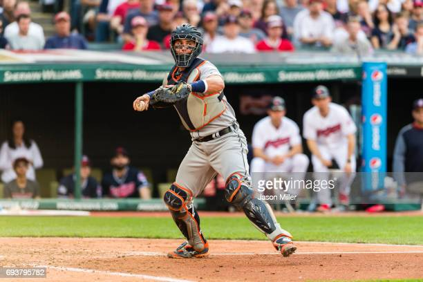 Catcher James McCann of the Detroit Tigers throws out Abraham Almonte of the Cleveland Indians at first during the fifth inning at Progressive Field...
