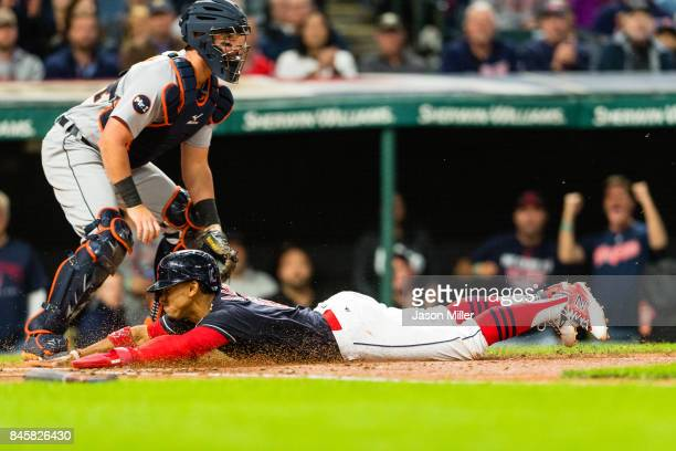 Catcher James McCann of the Detroit Tigers waits for the throw as Francisco Lindor of the Cleveland Indians scores during the second inning at...