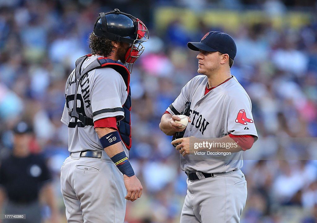 Catcher <a gi-track='captionPersonalityLinkClicked' href=/galleries/search?phrase=Jarrod+Saltalamacchia&family=editorial&specificpeople=836404 ng-click='$event.stopPropagation()'>Jarrod Saltalamacchia</a> #39 and pitcher <a gi-track='captionPersonalityLinkClicked' href=/galleries/search?phrase=Jake+Peavy&family=editorial&specificpeople=211320 ng-click='$event.stopPropagation()'>Jake Peavy</a> #44 of the Boston Red Sox confer on the mound in the fifth inning during the MLB game against the Los Angeles Dodgers at Dodger Stadium on August 25, 2013 in Los Angeles, California. The Red Sox defeated the Dodgers 8-1.