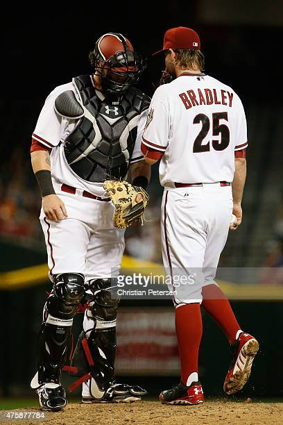 Catcher Jarrod Saltalamacchia of the Arizona Diamondbacks talks with pitcher Archie Bradley during the MLB game against the Atlanta Braves at Chase...