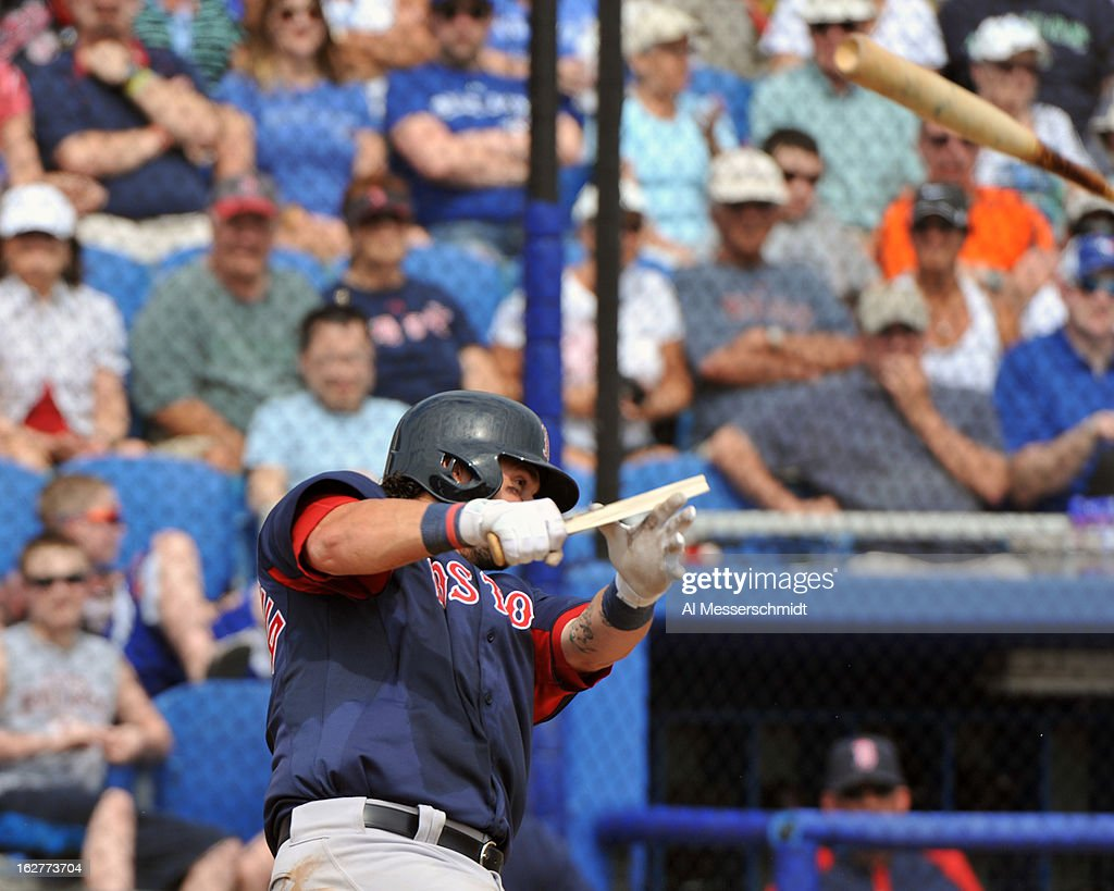 Catcher <a gi-track='captionPersonalityLinkClicked' href=/galleries/search?phrase=Jarrod+Saltalamacchia&family=editorial&specificpeople=836404 ng-click='$event.stopPropagation()'>Jarrod Saltalamacchia</a> #39 of the Boston Red Sox breaks a bat against the Toronto Blue Jays during a preason game February 25, 2013 at the Florida Auto Exchange Stadium in Dunedin, Florida.