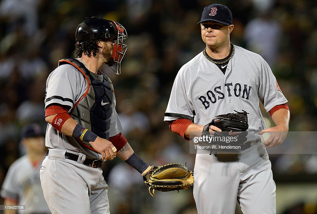 Catcher <a gi-track='captionPersonalityLinkClicked' href=/galleries/search?phrase=Jarrod+Saltalamacchia&family=editorial&specificpeople=836404 ng-click='$event.stopPropagation()'>Jarrod Saltalamacchia</a> #39 of the Boston Red Sox comes out to talk with pitcher <a gi-track='captionPersonalityLinkClicked' href=/galleries/search?phrase=Jon+Lester&family=editorial&specificpeople=832746 ng-click='$event.stopPropagation()'>Jon Lester</a> #31 in the sixth inning against the Oakland Athletics at O.co Coliseum on July 13, 2013 in Oakland, California.