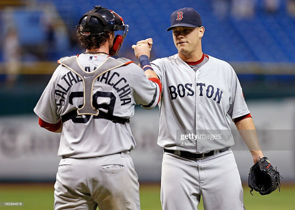 Catcher <a gi-track='captionPersonalityLinkClicked' href=/galleries/search?phrase=Jarrod+Saltalamacchia&family=editorial&specificpeople=836404 ng-click='$event.stopPropagation()'>Jarrod Saltalamacchia</a> #39 of the Boston Red Sox congratulates pitcher Andrew Bailey #40 after his save against the Tampa Bay Rays at Tropicana Field on September 18, 2012 in St. Petersburg, Florida.