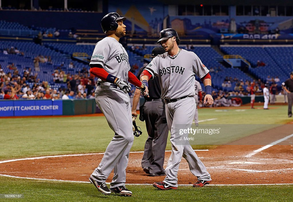 Catcher <a gi-track='captionPersonalityLinkClicked' href=/galleries/search?phrase=Jarrod+Saltalamacchia&family=editorial&specificpeople=836404 ng-click='$event.stopPropagation()'>Jarrod Saltalamacchia</a> #39 of the Boston Red Sox is congratulated by <a gi-track='captionPersonalityLinkClicked' href=/galleries/search?phrase=James+Loney&family=editorial&specificpeople=636293 ng-click='$event.stopPropagation()'>James Loney</a> #22 after both scored against the Tampa Bay Rays during the game at Tropicana Field on September 18, 2012 in St. Petersburg, Florida.