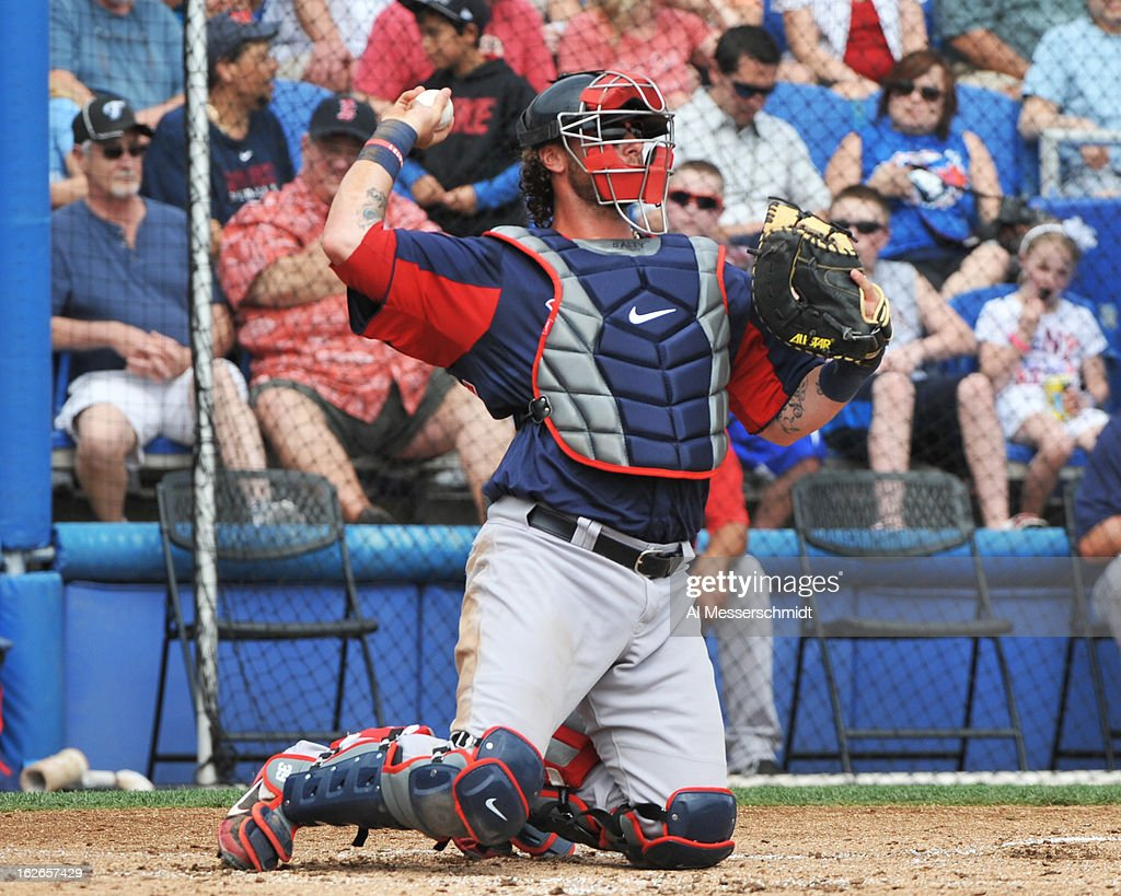 Catcher <a gi-track='captionPersonalityLinkClicked' href=/galleries/search?phrase=Jarrod+Saltalamacchia&family=editorial&specificpeople=836404 ng-click='$event.stopPropagation()'>Jarrod Saltalamacchia</a> #39 of the Boston Red Sox sets to throw against the Toronto Blue Jays during a preason game February 25, 2013 at the Florida Auto Exchange Stadium in Dunedin, Florida.