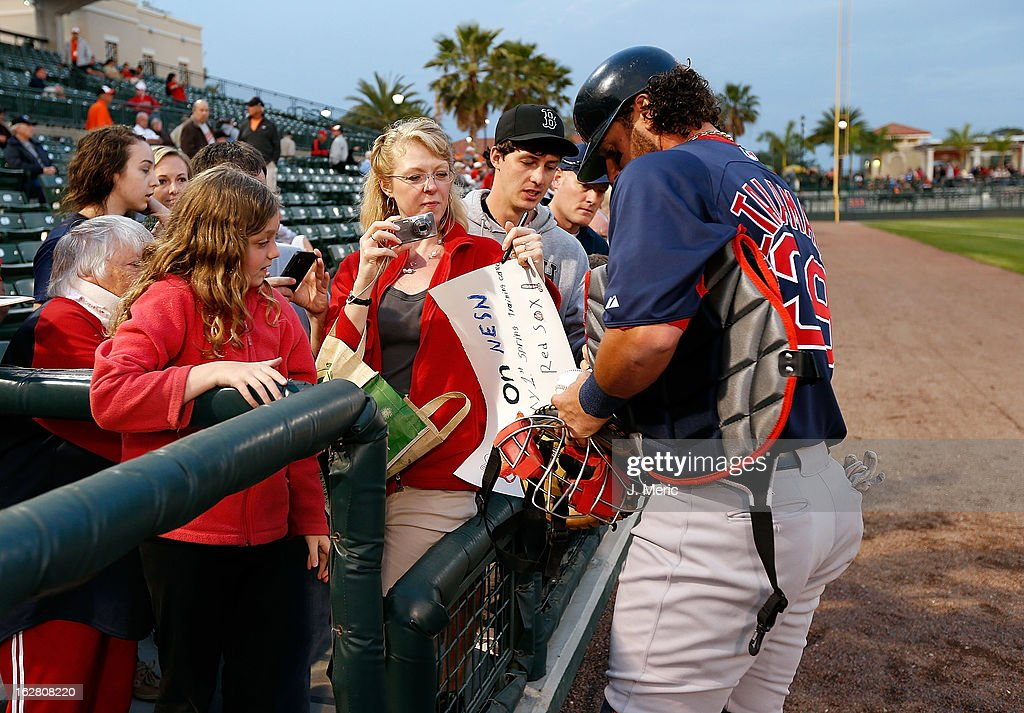 Catcher Jarrod Saltalamacchia #39 of the Boston Red Sox signs some autographs just before the start of the Grapefruit League Spring Training Game against the Baltimore Orioles at Ed Smith Stadium on February 27, 2013 in Sarasota, Florida.