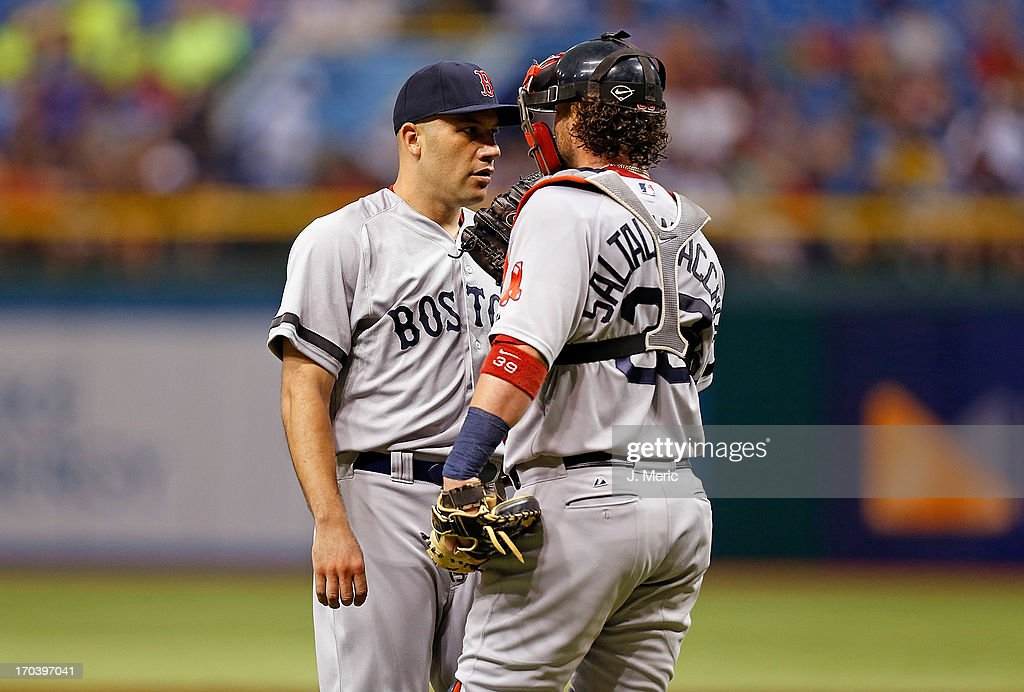 Catcher Jarrod Saltalamacchia #39 of the Boston Red Sox talks with pitcher Alfredo Aceves #91 during the game against the Tampa Bay Rays at Tropicana Field on June 12, 2013 in St. Petersburg, Florida.