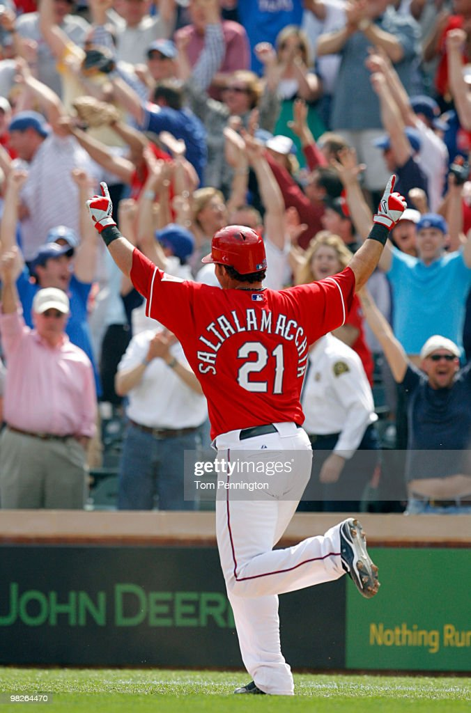 Catcher Jarrod Saltalamacchia of the Texas Rangers celebrates a walkoff RBI against the Toronto Blue Jays in the bottom of the ninth inning on...