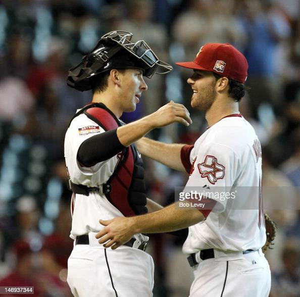 Catcher Jason Castro of the Houston Astros gives pitcher Dallas Keuchel a hug after pitching a complete game against the Cleveland Indians at Minute...