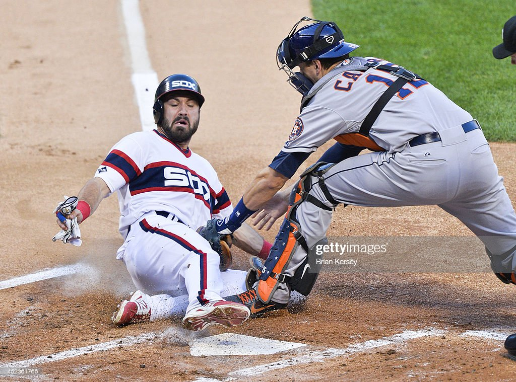 Catcher Jason Castro #15 of the Houston Astros (R) tags out <a gi-track='captionPersonalityLinkClicked' href=/galleries/search?phrase=Adam+Eaton&family=editorial&specificpeople=210898 ng-click='$event.stopPropagation()'>Adam Eaton</a> #1 of the Chicago White Sox as Eaton tried to tag up and score from third base on a fly ball hit by Alexei Ramirez during the first inning at U.S. Cellular Field on July 18, 2014 in Chicago, Illinois.