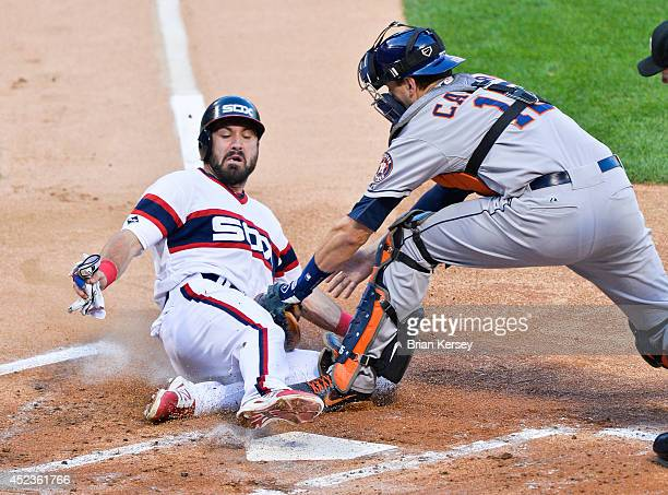 Catcher Jason Castro of the Houston Astros tags out Adam Eaton of the Chicago White Sox as Eaton tried to tag up and score from third base on a fly...