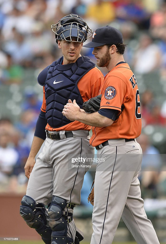 Catcher Jason Castro #15 of the Houston Astros talks with starting pitcher Dallas Keuchel #60 of the Houston Astros during the third inning against the Chicago Cubs at Wrigley Field on June 21, 2013 in Chicago, Illinois.