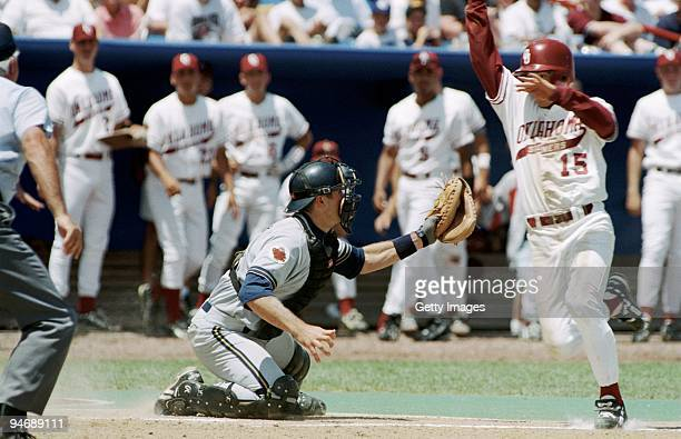 Catcher Jason Varitek of Georgia Tech Yellowjackets makes a controversial tag during the 1994 NCAA College Baseball World Series game against the...
