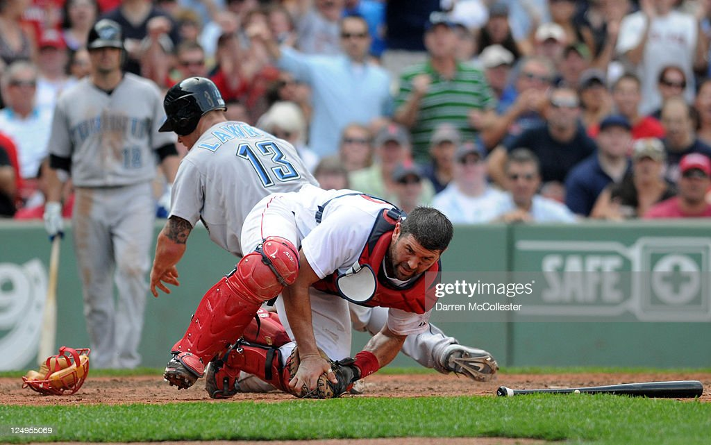 Catcher <a gi-track='captionPersonalityLinkClicked' href=/galleries/search?phrase=Jason+Varitek&family=editorial&specificpeople=171480 ng-click='$event.stopPropagation()'>Jason Varitek</a> #33 of the Boston Red Sox holds onto the ball after a collision at home plate with <a gi-track='captionPersonalityLinkClicked' href=/galleries/search?phrase=Brett+Lawrie&family=editorial&specificpeople=5496694 ng-click='$event.stopPropagation()'>Brett Lawrie</a> #13 of the Toronto Blue Jays during the sixth inning at Fenway Park on September 14, 2011 in Boston, Massachusetts.