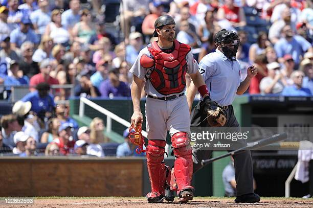 Catcher Jason Varitek of the Boston Red Sox looks at the play in the field as the ball is put into play during the game against the Kansas City...