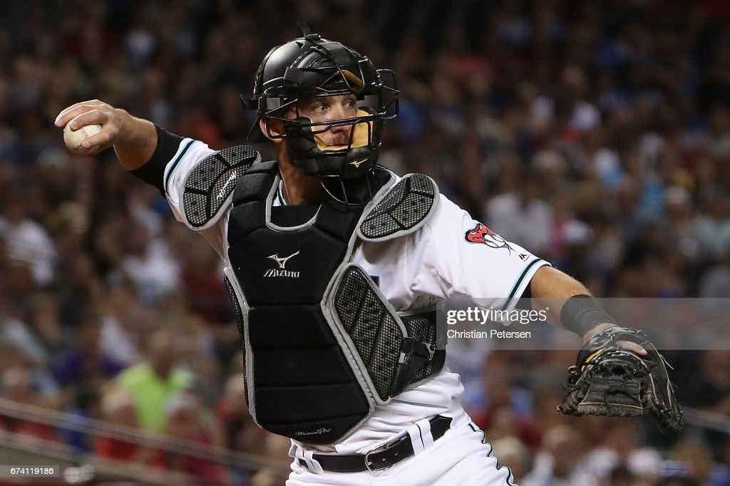 Catcher Jeff Mathis #2 of the Arizona Diamondbacks fields a ground ball out against the Los Angeles Dodgers during the MLB game at Chase Field on April 21, 2017 in Phoenix, Arizona.