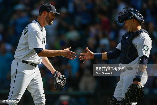Catcher Jesus Sucre and relief pitcher Tom Wilhelmsen of the Seattle Mariners after a 50 win over the Texas Rangers at Safeco Field on September 10...