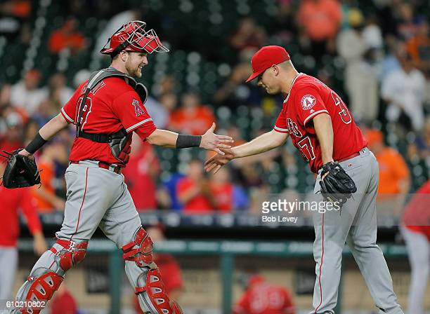 Catcher Jett Bandy of the Los Angeles Angels of Anaheim shakes hands with Andrew Bailey after the final out in the ninth inning against the Houston...
