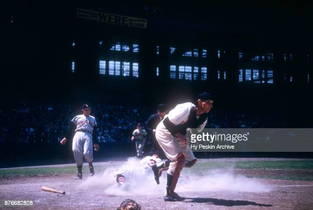 Catcher Jim Hegan of the Cleveland Indians steps on home plate for the out before Vern Stephens of the Chicago White Sox can score during an MLB game...