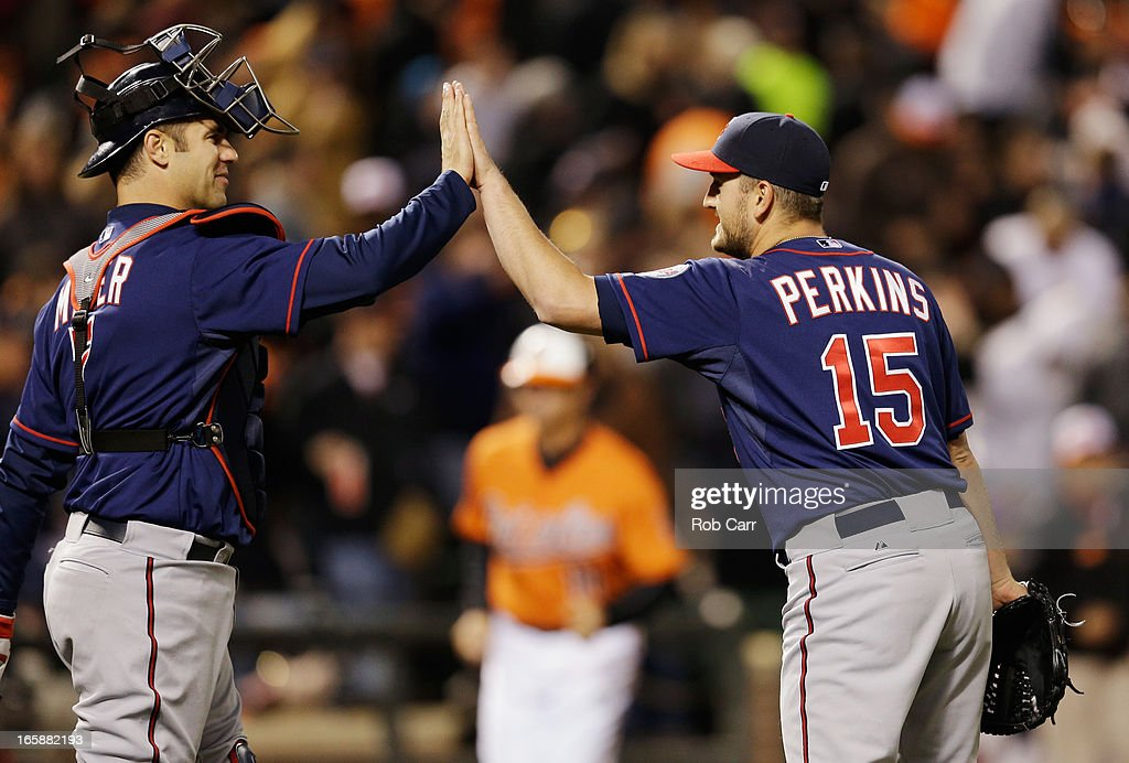 Catcher <a gi-track='captionPersonalityLinkClicked' href=/galleries/search?phrase=Joe+Mauer&family=editorial&specificpeople=214614 ng-click='$event.stopPropagation()'>Joe Mauer</a> #7 and relief pitcher <a gi-track='captionPersonalityLinkClicked' href=/galleries/search?phrase=Glen+Perkins&family=editorial&specificpeople=835845 ng-click='$event.stopPropagation()'>Glen Perkins</a> #15 of the Minnesota Twins celebrate following the Twins 6-5 win over the Baltimore Orioles at Oriole Park at Camden Yards on April 6, 2013 in Baltimore, Maryland.
