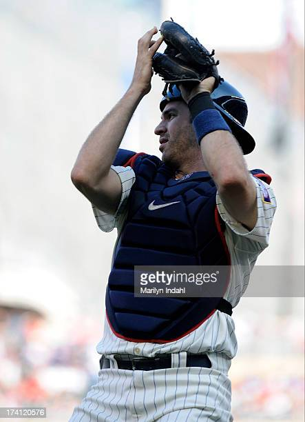 Catcher Joe Mauer of the Minnesota Twins catches a foul ball in the first inning of the game against the Cleveland Indians at Target Field on July 20...